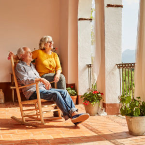 senior couple on patio looking at view